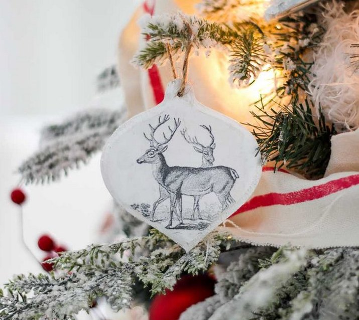 handmade wood transfer ornament with image of reindeer in b&w