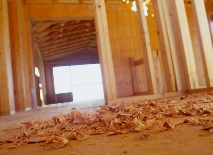 An image of wood shavings on the floor.