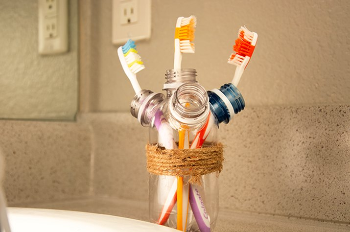 An image of a toothbrush holder made from old plastic bottles.