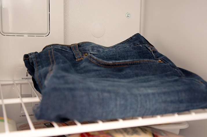 An image of denim jeans in the freezer.
