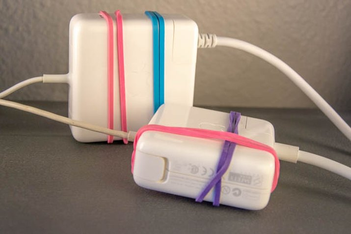 An image of Mac Book power cords and rubber band hacks