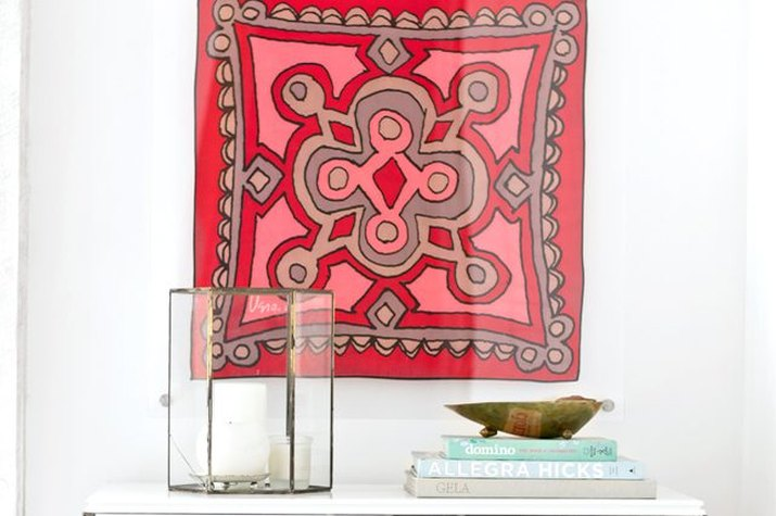 Bright, bold scarf framed in clear lucite