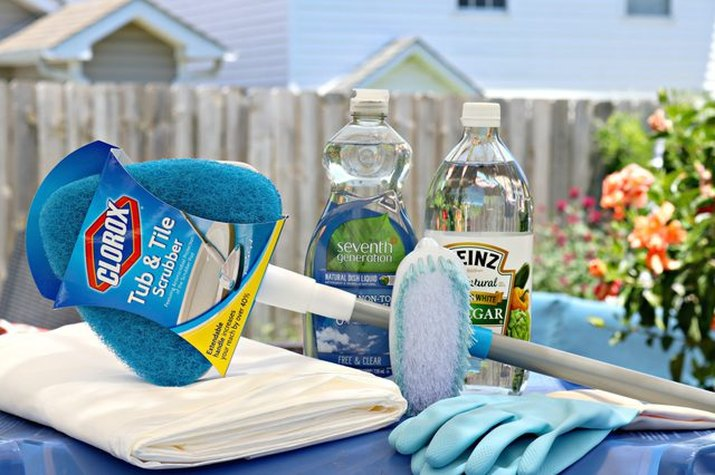 Tub and tile scrubber, dish soap and vinegar are used to freshen outdoor trash cans