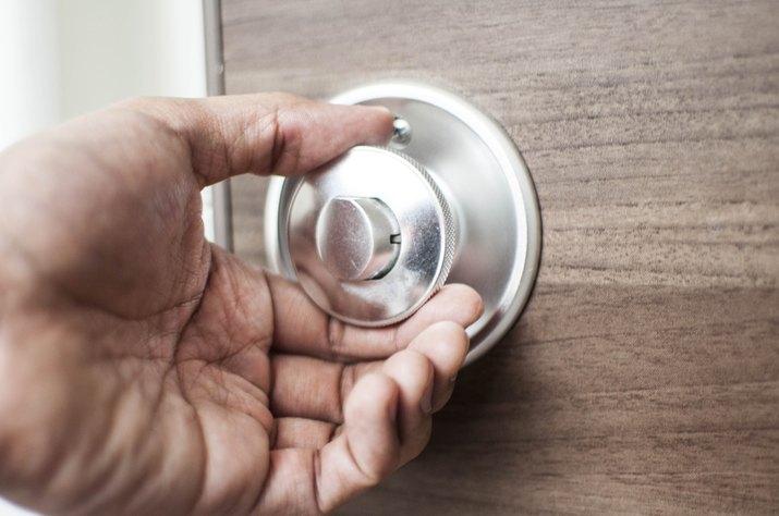 Holding a modern door knob