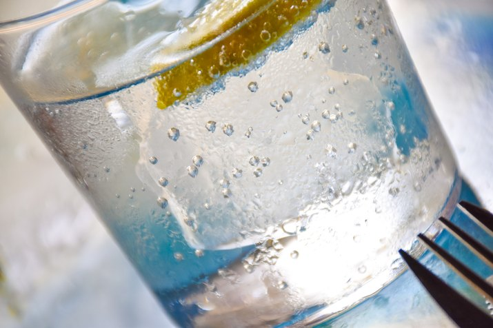 Glass of soda with lemon, closeup