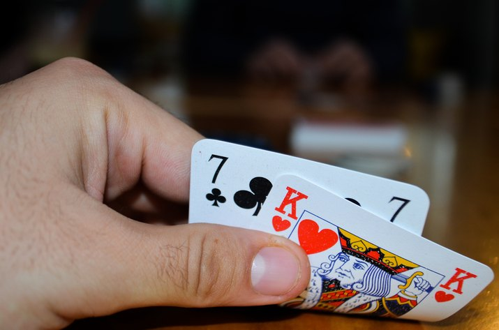 Cropped Hand Of Man Holding Playing Cards