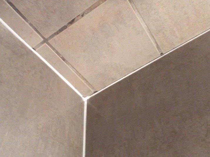fresh caulk on shower tile