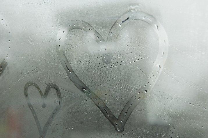 Hearts drawn on fogged window