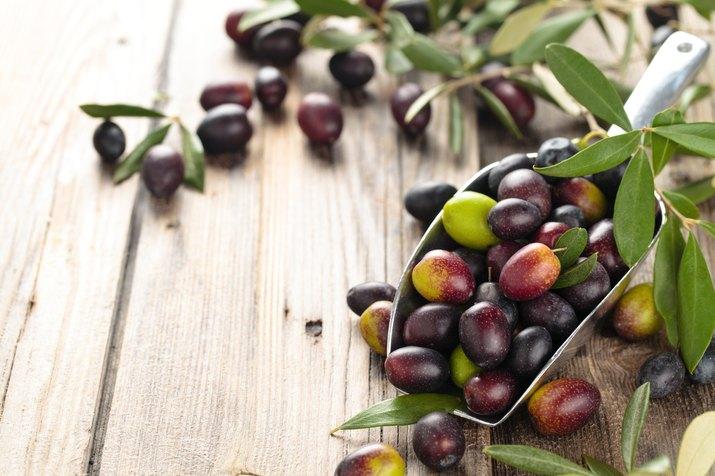 Fresh olives in scoop.