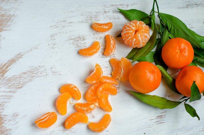 Ripe tangerines on white background