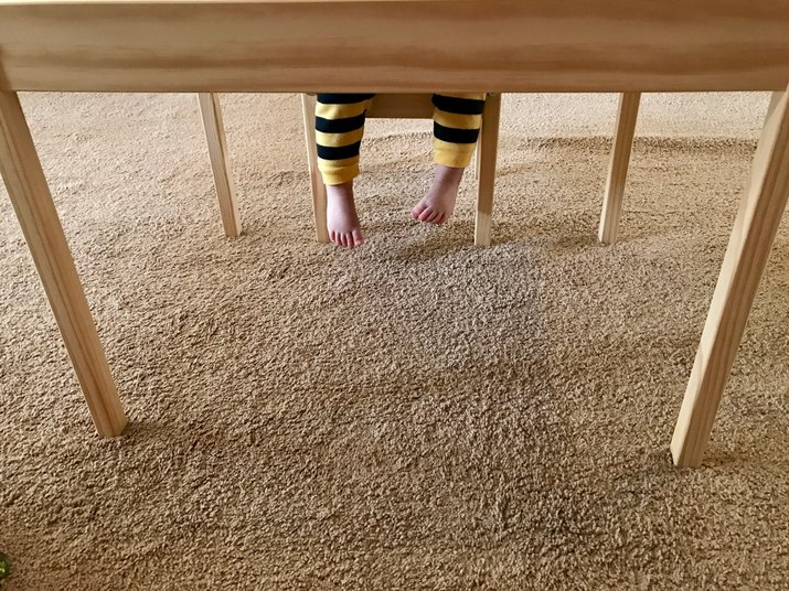 Little legs under the table