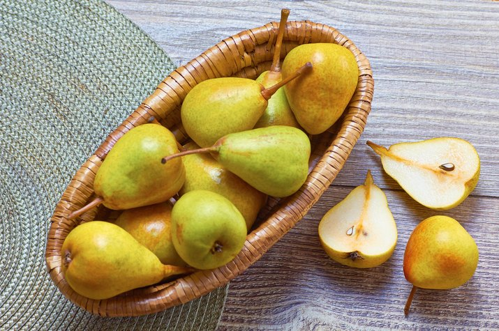 Pears in basket on table
