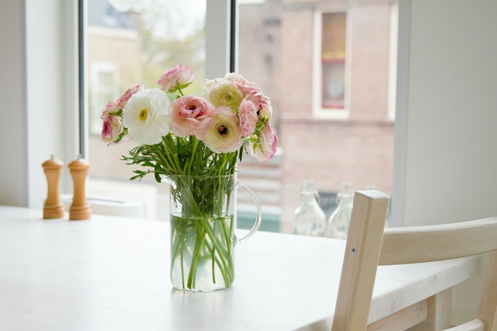 Flowers In Vase On Table At Home