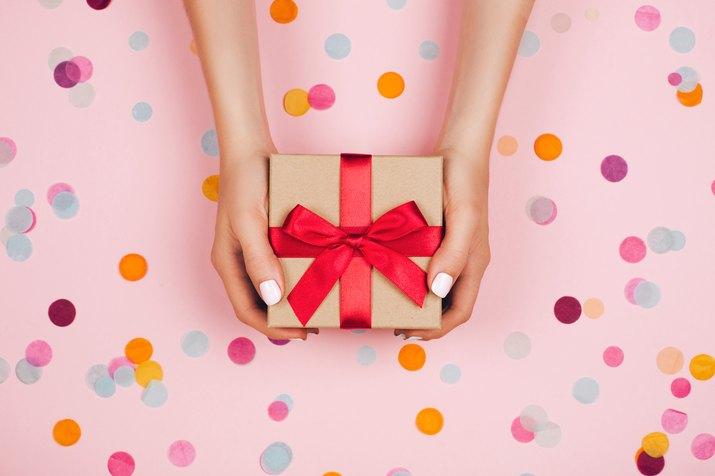 Hands holding present box