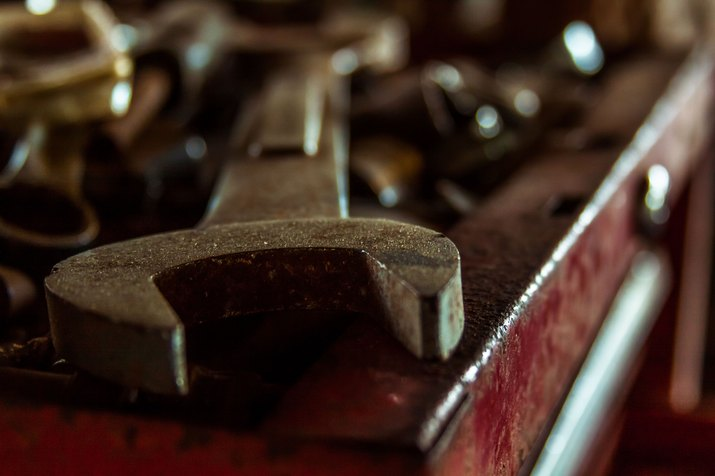 rusty wrench on toolbox