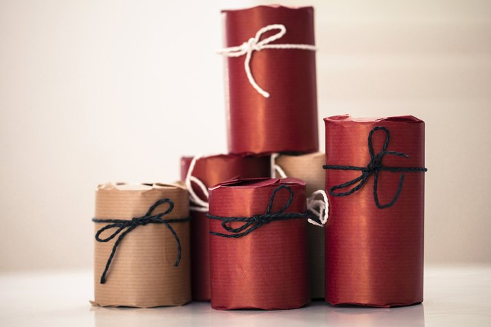 Wrapped objects on colored background