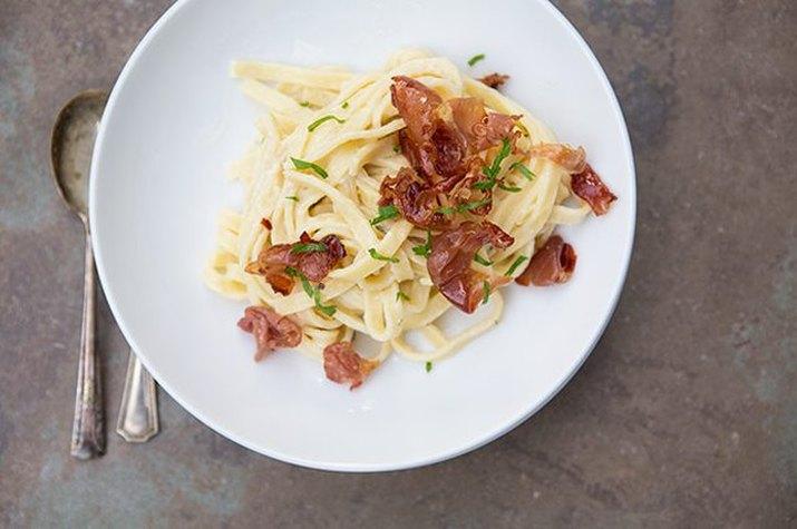 Prosciutto carbonara pasta with fresh herbs
