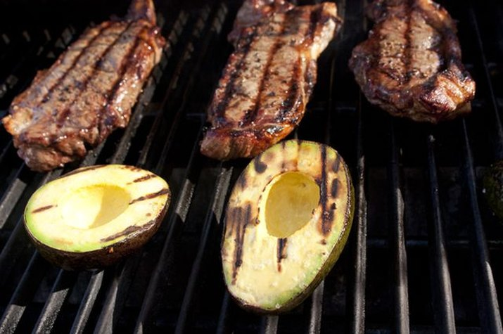 steaks and avocados on the grill