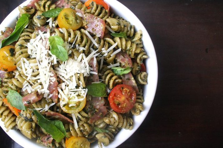 Italian pasta salad with cherry tomatoes and shredded parmesan