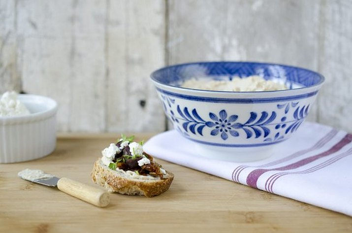 A single serving of Mediterranean crostini served with extra feta cheese.