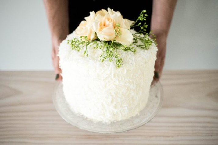A beautifully decorated Tres Leches cake studded with shredded coconut.