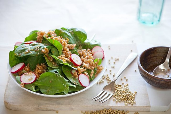 Spinach farro salad with orange and toasted coriander vinaigrette
