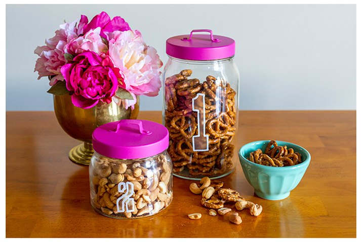 Etched glass jars filled with snacks