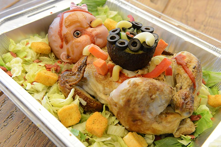 Roasted whole chicken on a salad.