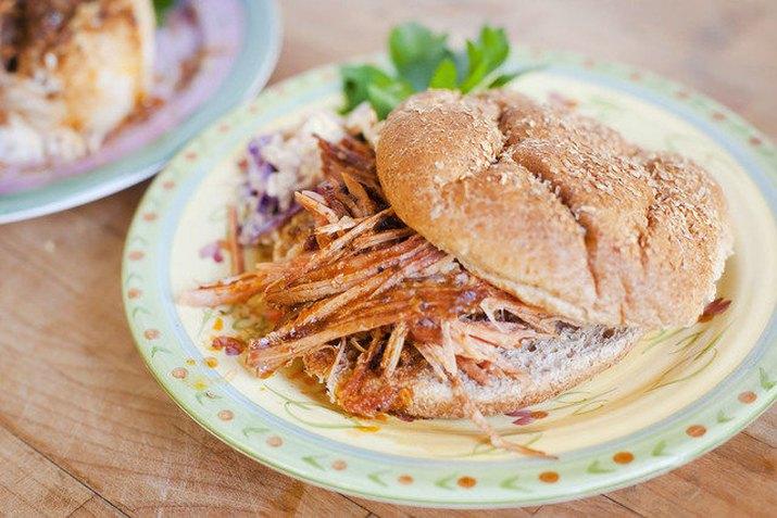 pulled pork sandwich on kaiser roll