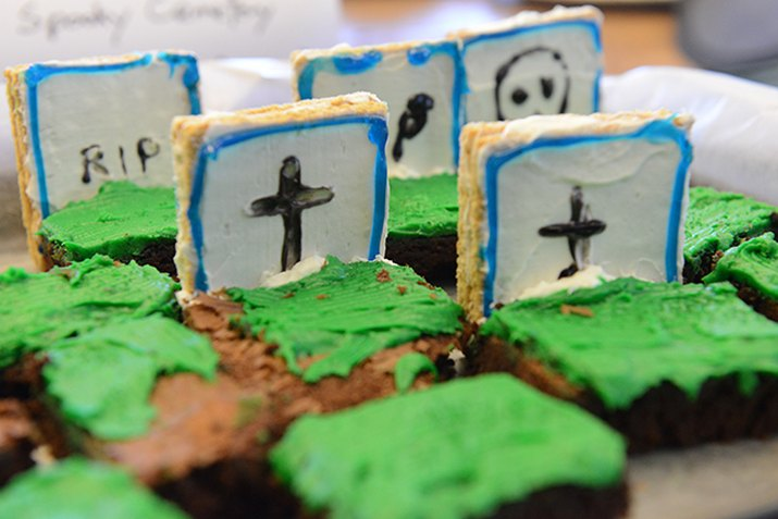 Brownies with green icing and graham cracker tombstones.