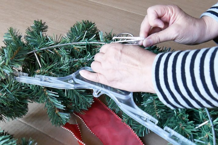 Attaching wreath to plastic hanger