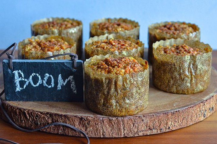 Seven freshly baked protein-loaded sweet potato and oatmeal mini-casseroles.