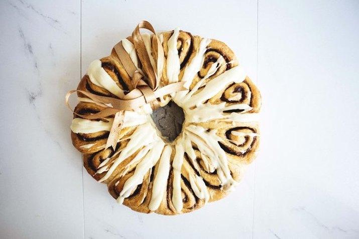 Bring a cinnamon roll wreath as a holiday gift.