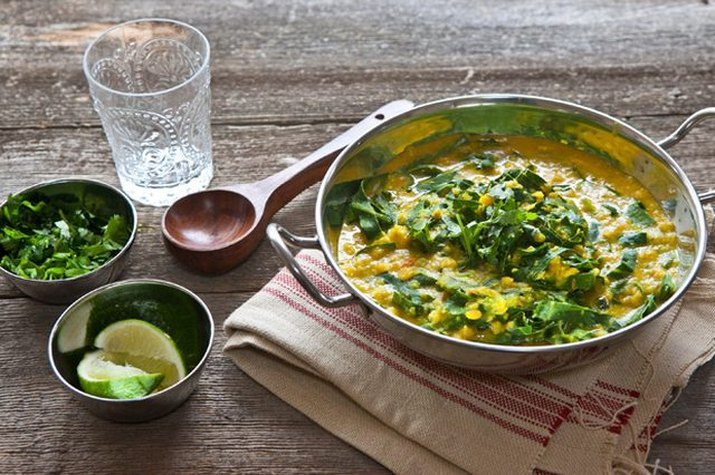 A bowl of Indian lentils with collard greens.