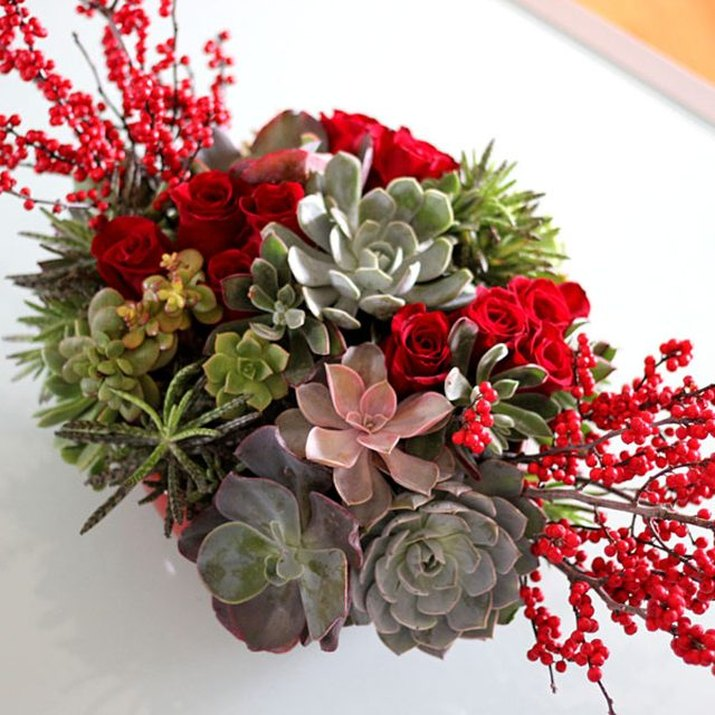 Add berries and flowers to your succulents for a colorful display of holiday cheer.