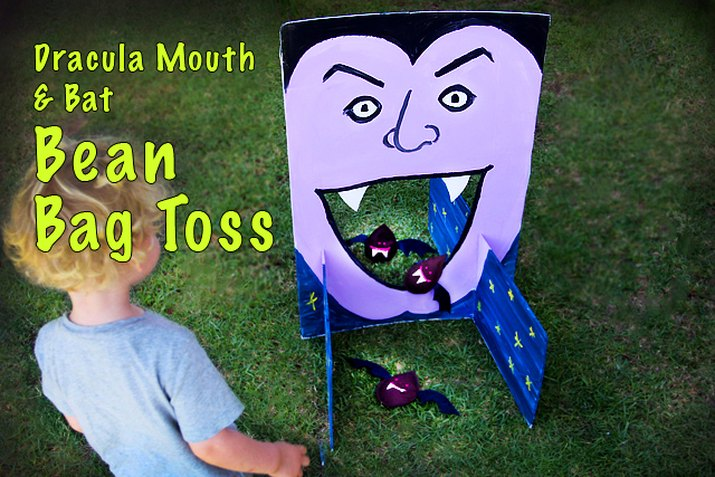 A purple-face painted onto foam core with a hollow mouth and bat shaped bean bags