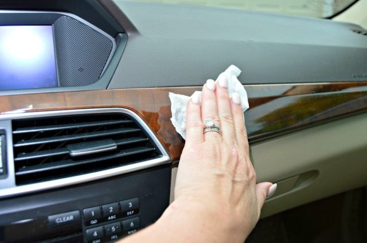 DIY car interior cleaning wipe in action