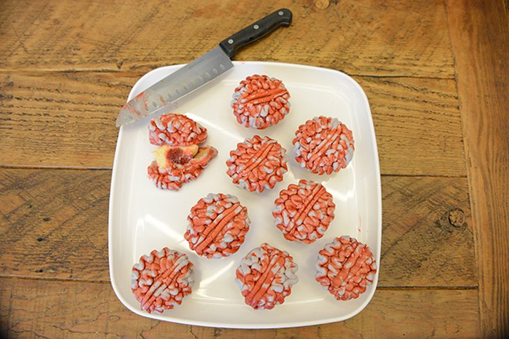 Brain decorated cupcakes with jelly filling.