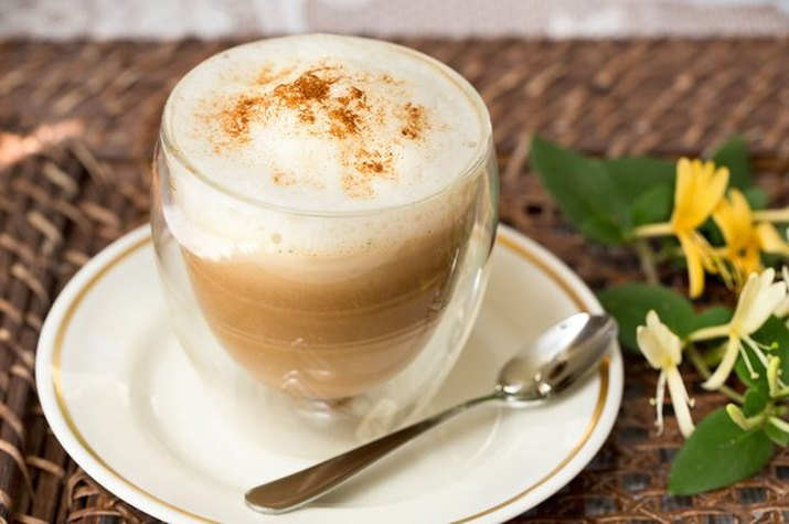 A fresh cup of pumpkin spice cappuccino sprinkled with pumpkin pie spice.