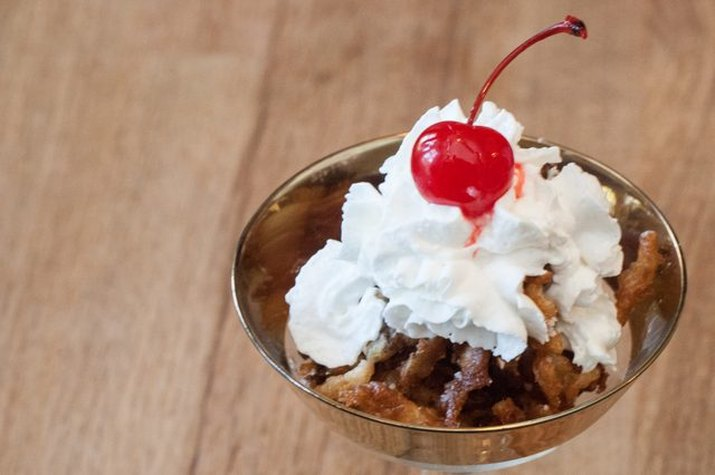 Deep-fried Coke topped with whipped cream and a cherry.