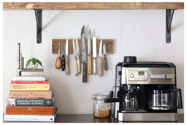 Magnetic knife rack on display in the kitchen