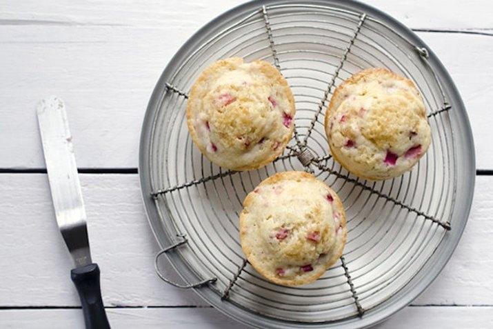 Three muffins on a round wire rack.