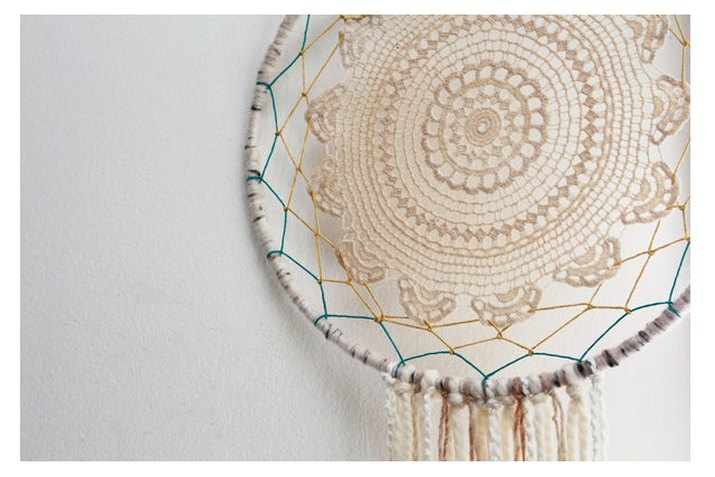 lace doily dreamcatcher hanging on wall