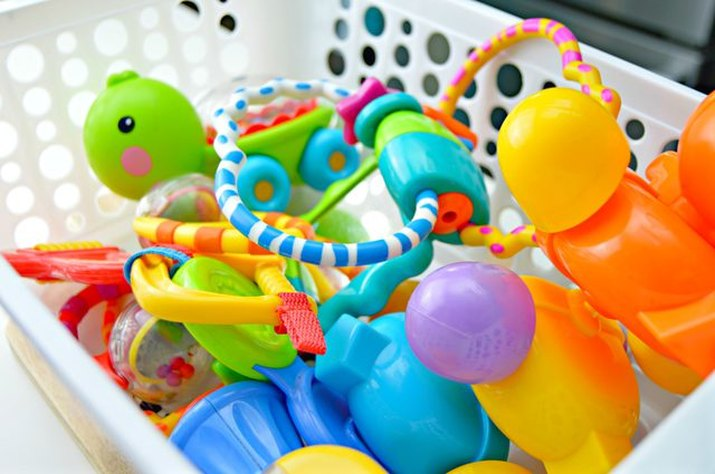 Laundry basket filled with clean, disinfected baby toys