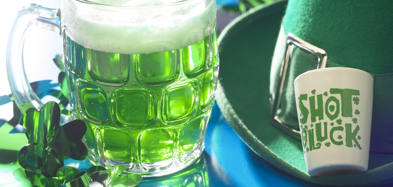 Green beer and a shot glass