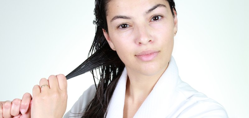 Woman applying product to hair