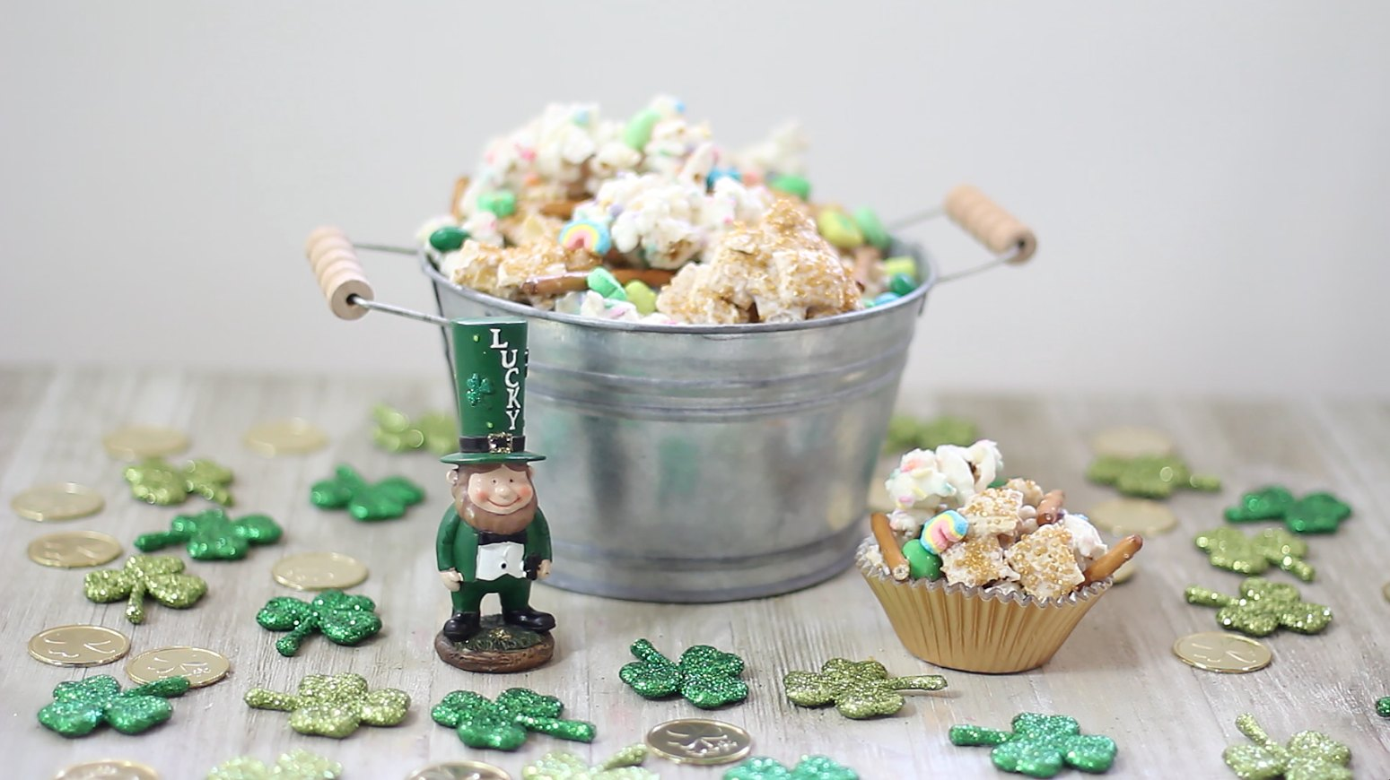 leprechaun standing next to a bucket full of lucky leprechaun munch